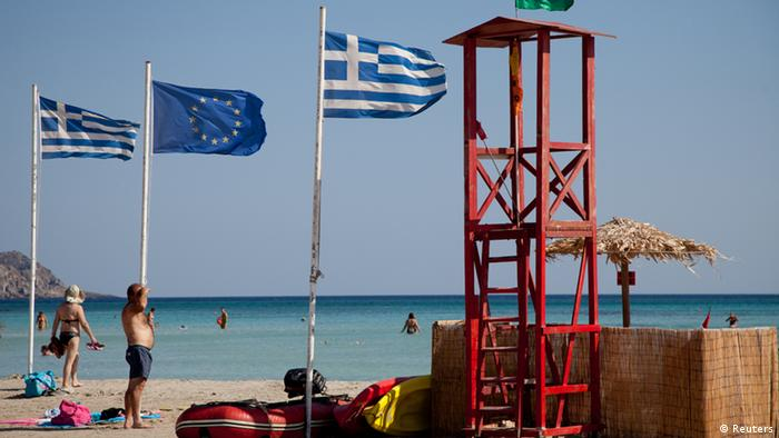 A beach in Crete with flags