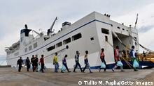 GettyImages 183544223 LAMPEDUSA, ITALY - OCTOBER 07: Immigrants board a ship bound for Porto Empedocle, Sicily on October 7, 2013 in Lampedusa, Italy. The search for bodies continues off the coast of Southern Italy as the death toll of African migrants who drowned as they tried to reach the island of Lampedusa is expected to reach over 300 people. The tragedy has bought fresh questions over the thousands of asylum seekers that arrive into Europe by boat each year. (Photo by Tullio M. Puglia/Getty Images)
