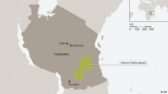 A map of the round-ish Tanzania in gray shows a green section in the lower half of the country demarcating a wildlife refuge