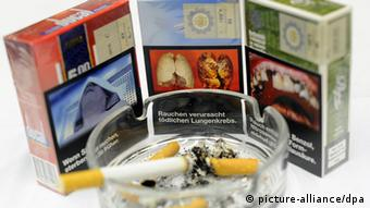 Examples of how the health warnings could soon look on German cigarette packs - presented in September last year at the opening press conference of the Tobacco Trade Fair in inter-tabac the Westfalenhallen, Dortmund, Germany (Photo: Jonas Güttler/dpa (zu dpa: Tabakrichtlinie/EU vom 08.10.2013) +++(c) dpa - Bildfunk+++)