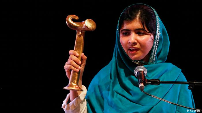 Pakistan's Malala Yousafzai gives a speech after receiving the RAW (Reach All Women) in War Anna Politkovskaya Award at the Southbank Centre in London October 4, 2013. (Photo: REUTERS/Luke MacGregor )