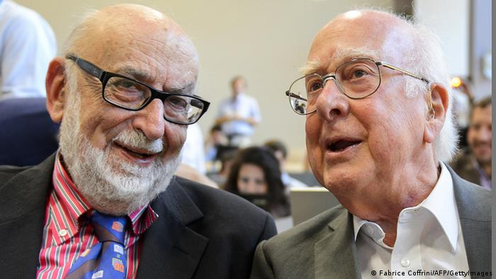 Nobel Laureates Francois Englert (L) and Peter Higgs (R) chat at a press at CERN in 2012 where the elusive Higgs boson fundamental particle was detected