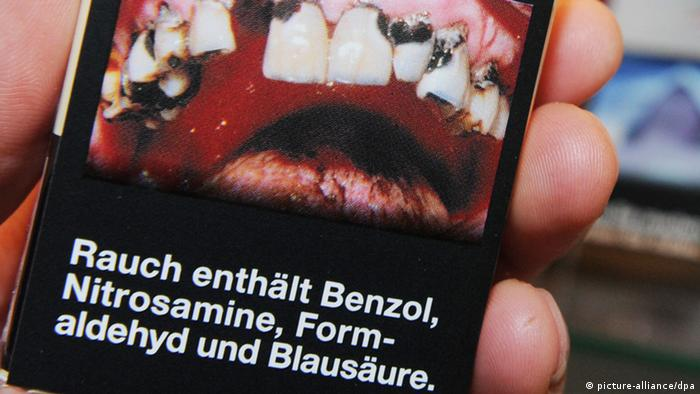 A pack of cigarettes with a picture of rotting teeth on it. (Photo: Angelika Warmuth/dpa)