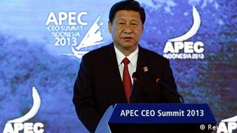 China's President Xi Jinping speaks at the Asia-Pacific Economic Cooperation (APEC) CEO Summit in Nusa Dua, on the Indonesian resort island of Bali October 7, 2013. REUTERS/Edgar Su (INDONESIA - Tags: POLITICS)