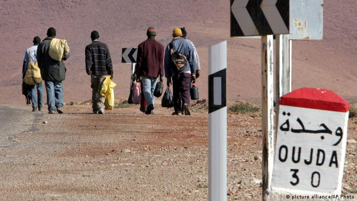A group of sub-Saharan migrants make their way on foot to the Moroccan town of Oujda