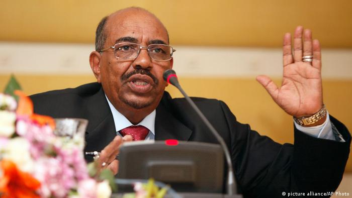 FILE - In this Jan. 7, 2012 file photo, Sudanese President Omar al-Bashir speaks to reporters during a visit to Tripoli, Libya. Sudan on Wednesday, Sept. 20, 2013 condemned the United States for suggesting that al-Bashir should turn himself in to the International Criminal Court before heading to the United Nations General Assembly meeting in New York. (AP Photo Abdel Magid al-Fergany, File)