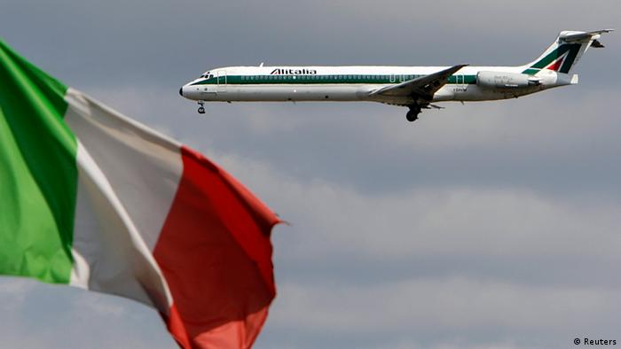An Alitalia plane approaches to land as an Italian flag is seen at Fiumicino international airport in Rome REUTERS/Max Rossi/Files (
