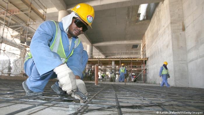 Migrant labourers work on a construction site on October 3, 2013 in Doha in Qatar. (Photo: AFP)