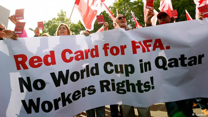 Members of the Swiss UNIA workers union display red cards and shout slogans during a protest in front of the headquarters of soccer's international governing body FIFA in Zurich October 3, 2013. (Photo: Reuters)