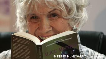 Canadian author Alice Munro holds one of her books as she receives her Man Booker International award at Trinity College Dublin, in Dublin, Ireland, on June 25, 2009. Canadian short story writer Alice Munro has won this year's Man Booker International Prize worth 60,000 pounds (95,000 US dollars, 70,000 euros). It is awarded every two years, and since its creation in 2005 has been given to Albania's Ismail Kadare and Nigeria's Chinua Achebe. The panel, which comprised writers Jane Smiley, Amit Chaudhuri and Andrey Kurkov, praised the 77-year-old for the originality and depth of her work. AFP PHOTO/ Peter Muhly (Photo credit should read PETER MUHLY/AFP/Getty Images)