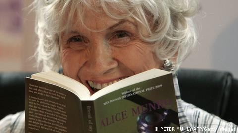 Canadian author Alice Munro holds one of her books
