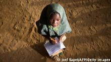 A young girl writes during a lesson at Thionville Chateau school in Gao, Mali on April 12, 2013. AFP PHOTO / JOEL SAGET (Photo credit should read JOEL SAGET/AFP/Getty Images)