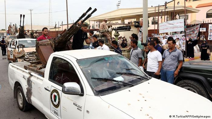 Members of the security forces are seen outside the appeals court in Tripoli during the pre-trial hearing of ex-intelligence chief Abdullah Senussi and more than 20 former regime officials, accused of crimes during the 2011 revolt, on September 19, 2013. An AFP journalist said Senussi and more than 20 former regime officials appeared in court in the capital amid heavy security while Seif al-Islam Kadhafi, son of slain dictator Moamer Kadhafi, stood briefly in the dock before a judge adjourned his case in the western town of Zintan. AFP PHOTO / MAHMUD TURKIA (Photo credit should read MAHMUD TURKIA/AFP/Getty Images)