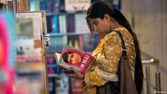 A woman browses a copy of Malala Yousufzai's book I am Malala at a book store in Islamabad October 8, 2013. (Photo: REUTERS/Mian Khursheed)