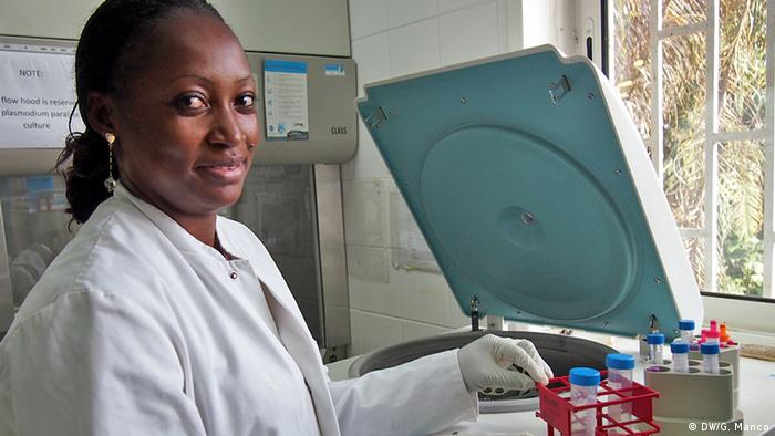 Eunice Betouke Ongwe analysing blood samples for the malaria trial (Photo: Gaia Manco)