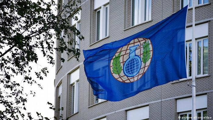The flag of the Organization for the Prohibition of Chemical Weapons (OPCW) in front of their building in The Hague, The Netherlands. Photo: EPA/GUUS SCHONEWILLE