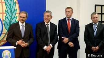 Malik Ellahi, political adviser to Director General Ahmet Uzumcu, External Relations Director and team leader Wang Ju, Declarations Branch head Nihad Alihodzic and Chemical Demilitarisation Branch head Dominique Anelli (L-R) attending a news conference in The Hague, October 9, 2013. The Organisation for the Prohibition of Chemical Weapons (OPCW), which is overseeing the destruction's of Syria's arsenal, won the Nobel Peace Prize, the Norwegian Nobel Committee said October 11, 2013. Set up in 1997 to eliminate all chemicals weapons worldwide, its mission gained critical importance this year after a sarin gas strike in the suburbs of Damascus killed more than 1,400 people in August. REUTERS/Toussaint Kluiters/United Photos/Files (NETHERLANDS - Tags: POLITICS)
