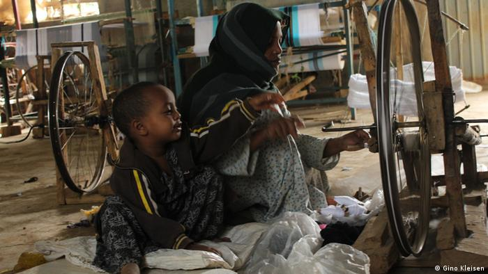 Woman and child in the spinning workshop in Awra Amba