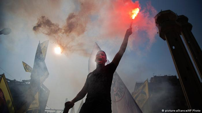 A supporter of Egypt's ousted President Mohammed Morsi holds a flare and chants slogans against the army during a protest (Photo: AP Photo/ Hassan Ammar)