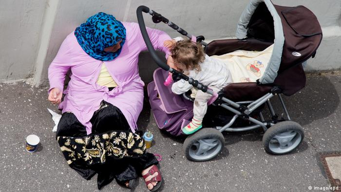 A symbolic picture of a poverty from eastern Europe showing an old woman and a baby carriage. (Photo: imago/epd)