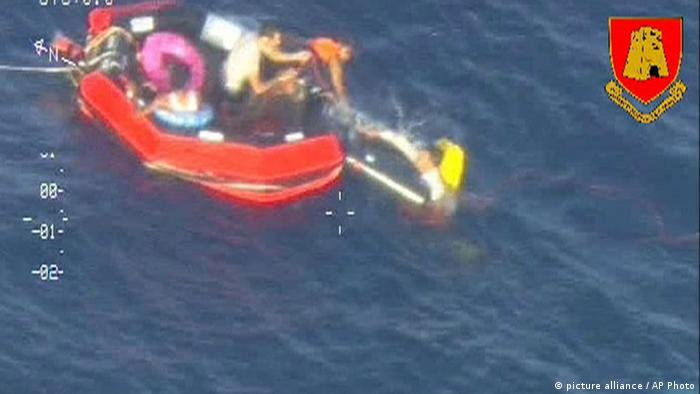 In this video image made available by the Armed Forces of Malta from an overflying aircraft, a life raft carrying survivors floats in the sea between Malta and the Italian island of Lampedusa, Friday Oct. 11 2013, following the capsize of a boat carrying an estimated 200 migrants. Rescue crews reported seeing bodies in the water but the coast guard said most of the passengers had been rescued. Another shipwreck of a migrants seeking to enter Europe the previous week left at least 339 dead. (AP Photo/ Armed Forces of Malta)