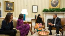 U.S. President Barack Obama (R), First Lady Michelle Obama (2nd L), and their daughter Malia (L) meet with Malala Yousafzai, the Pakistani schoolgirl who was shot in the head by the Taliban a year ago, in the Oval Office of the White House in Washington October 11, 2013. The 16-year-old was shot for campaigning for education for girls. REUTERS/Pete Souza/The White House/Handout via Reuters (UNITED STATES - Tags: POLITICS SOCIETY TPX IMAGES OF THE DAY) ATTENTION EDITORS � THIS IMAGE WAS PROVIDED BY A THIRD PARTY. FOR EDITORIAL USE ONLY. NOT FOR SALE FOR MARKETING OR ADVERTISING CAMPAIGNS. THIS PICTURE IS DISTRIBUTED EXACTLY AS RECEIVED BY REUTERS, AS A SERVICE TO CLIENTS