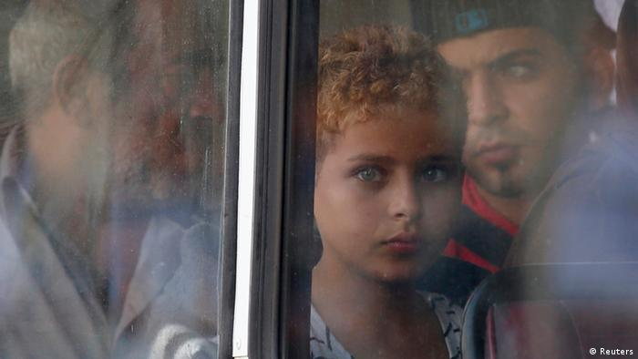 A rescued migrant child looks out of the window of a police bus after arriving at the Armed Forces of Malta Maritime Squadron base at Haywharf in Valletta's Grand Harbour October 12, 2013. Dozens of people died on Friday when a boat carrying around 250 migrants capsized between Sicily and Tunisia, in the second such shipwreck this month, the Italian coastguard said. 147 survivors, believed to all be Syrians, arrived in Malta on Saturday morning, according to local media. REUTERS/Darrin Zammit Lupi (MALTA - Tags: SOCIETY IMMIGRATION DISASTER) MALTA OUT. NO COMMERCIAL OR EDITORIAL SALES IN MALTA
