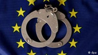 handcuffs and an EU flag