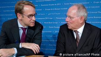 German Finance Minister Wolfgang Schaeuble, right, speaks with Bundesbank President Jens Weidmann in a news conference during the World Bank/IMF Annual Meetings at IMF headquarters, Saturday, Oct. 12, 2013, in Washington. World finance officials prepared to wrap up three days of meetings in Washington, where fretting about the risk of an unprecedented U.S. debt default overshadowed myriad worries about a shaky global economic recovery. ( AP Photo/Jose Luis Magana)