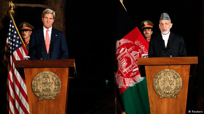 Afghanistan's President Hamid Karzai (R) speaks during a joint news conference with U.S. Secretary of State John Kerry in Kabul October 12, 2013. (Photo: Reuters)