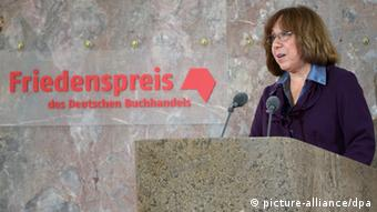 During her speech, she also depicted some of the 'hellish' sides of human beings Copyright: Arne Dedert/dpa