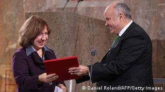 German publisher Gottfried Honnefelder (R), chairman of the German Book Trade Association, awards Belarusian journalist and writer Svetlana Alexievich the German Book Trade Peace Prize on October 13, 2013 at the Paul's Church in Frankfurt am Main, western Germany. The German Book Trade Peace Prize (Friedenspreis des Deutschen Buchhandels) is awarded since the year 1950 and is worth 25,000 euros. AFP PHOTO / DANIEL ROLAND (Photo credit should read DANIEL ROLAND/AFP/Getty Images)