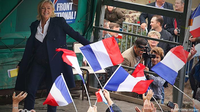 President of the French far-right Front National (FN) party Marine Le Pen acknowledges the crowd after a meeting during a visit in the French northeastern village of Brachay on October 6, 2013. (Photo: FRANCOIS NASCIMBENI/AFP/Getty Images)