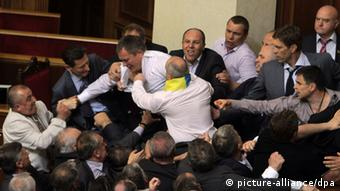 Ukrainian parliament members fight in the Verkhovna Rada in Kiev in a protest against the bill that would introduce Russian as the second official language. Center, wearing white: Regional Party member Vadim Kolesnichenko. Grigoriy Vasilenko/RIA Novosti