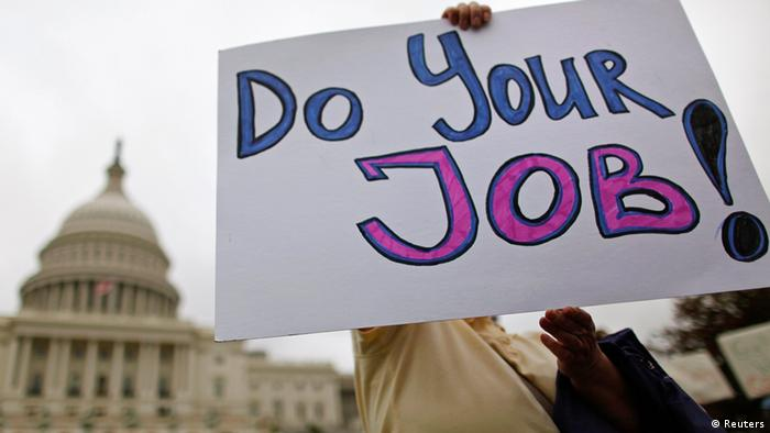 protester holds poster: do your job