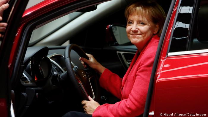 FRANKFURT AM MAIN, GERMANY - SEPTEMBER 17: German Chancellor Angela Merkel sits inside a Opel Astra car at the Opel trade-show booth during the international motor show IAA on September 17, 2009 in Frankfurt am Main, Germany.The world's biggest auto show runs until September 27. (Photo by Miguel Villagran/Getty Images)