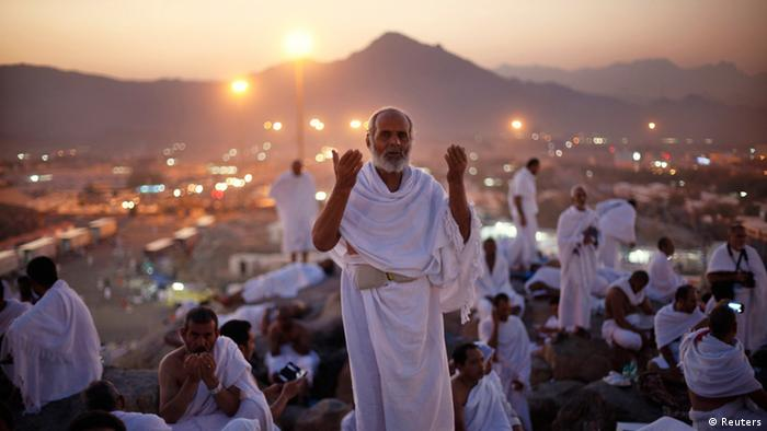 A Muslim pilgrim prays atop Mount Mercy on the plains of Arafat during the peak of the annual haj pilgrimage, near the holy city of Mecca early morning October 14, 2013. An estimated two million Muslims were in Mecca, Saudi Arabia, on Monday morning for the start of the annual Haj pilgrimage. REUTERS/Ibraheem Abu Mustafa (SAUDI ARABIA - Tags: SOCIETY RELIGION)
