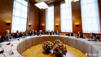 Delegations from Iran and other world powers sit before the start of two days of closed-door nuclear talks at the United Nations offices in Geneva October 15, 2013. Photo: REUTERS/Fabrice Coffrini/Pool