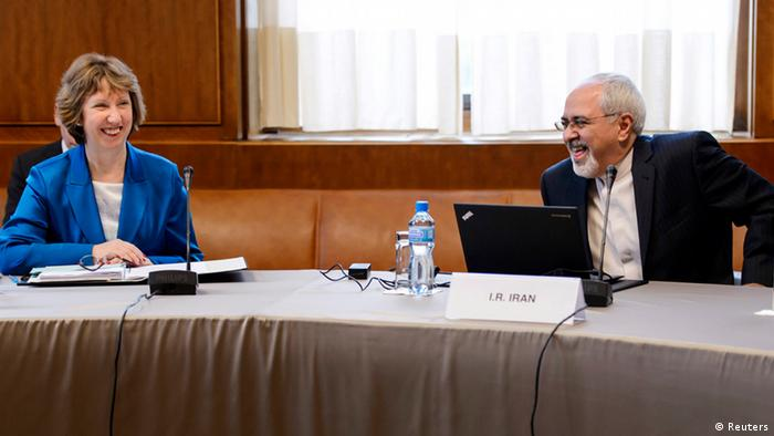 European Union foreign policy chief Catherine Ashton (L) laughs with Iranian Foreign Minister Mohammad Javad Zarif at the start of two days of closed-door nuclear talks at the United Nations offices in Geneva October 15, 2013. World powers and Iran began fresh talks on Tehran's controversial nuclear programme, after a six-month hiatus over its refusal to curb uranium enrichment in exchange for easing sanctions. REUTERS/Fabrice Coffrini/Pool (SWITZERLAND - Tags: POLITICS ENERGY)