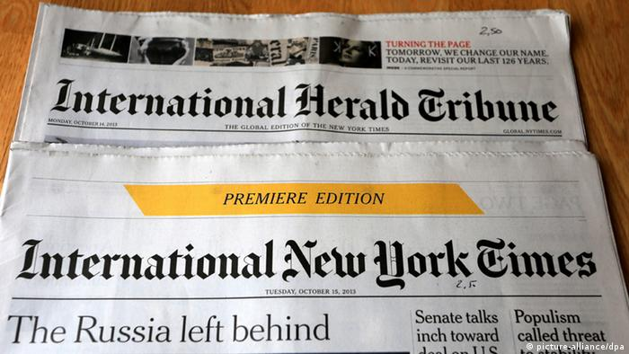 Front pages of the last edition of International Herald Tribune dated 1.10.2013 and Premiere Edition of the International New York Times, as seen in Italy on October 15, 2013 (Photo: © Pierre Teyssot / Maxppp)