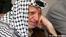 RAMALLAH, WEST BANK - OCTOBER 4: In this handout image provided by the PPO, Palestinian leader Yasser Arafat listens as he attends a meeting with a Jenin governate delegation October 4, 2004 in Ramallah, West Bank. Over the weekend, Arafat called on Israeli to end its military campaign in Gaza. (Photo by Hussein Hussein/PPO via Getty Images)