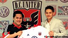 epa03724397 A photograph made available on 31 May 2013 shows Indonesian business tycoon Erick Thohir, owner of US soccer team D.C. United (L), holding a D.C. United jersey with Indonesian soccer player Syamsir Alam (R), during a press conference in Jakarta, Indonesia, 02 February 2013. According to media reports Thohir is in talks on buying Italian soccer team Inter Milan. EPA/YAN ARMAND