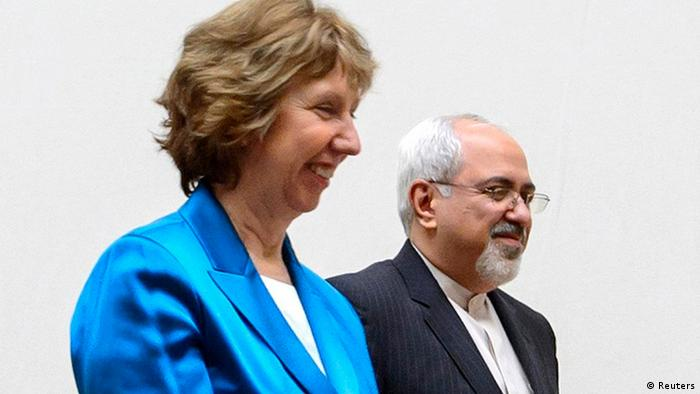 European Union foreign policy chief Catherine Ashton (L) walks next to Iranian Foreign Minister Mohammad Javad Zarif during a photo opportunity before the start of two days of closed-door nuclear talks at the United Nations offices in Geneva October 15, 2013. Iran will face pressure on Tuesday to propose scaling back its nuclear programme to win relief from crippling sanctions as talks between world powers and Tehran resume after a six-month hiatus. REUTERS/Fabrice Coffrini/Pool (SWITZERLAND - Tags: ENERGY POLITICS)