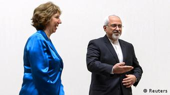 Iranian Foreign Minister Mohammad Javad Zarif (R) gestures next to EU High Representative for Foreign Affairs Catherine Ashton during a photo-op prior the start of two days of closed-door nuclear talks on October 15, 2013 at the United Nations offices in Geneva. World powers and Iran began fresh talks on Tehran's controversial nuclear programme, after a six-month hiatus over its refusal to curb uranium enrichment in exchange for easing sanctions. AFP PHOTO / POOL / FABRICE COFFRINI (Photo credit should read FABRICE COFFRINI/AFP/Getty Images)