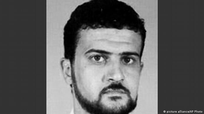 FILE - This file image from the FBI website shows Al Qaeda leader Abu Anas al-Libi. Al-Libi, who was captured in an Oct. 5, 2013, raid and held aboard a U.S. warship, is now in the United States. He is expected to stand trial over whether he helped plan and conduct surveillance for the bombings of U.S. embassies in Africa in 1998.