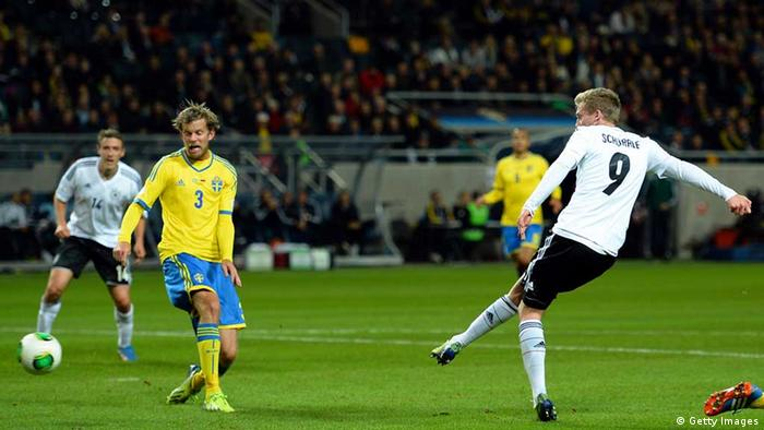 STOCKHOLM, SWEDEN - OCTOBER 15: Andre Schuerrle scores his teams third goal during the FIFA 2014 World Cup Qualifying Group C match between Sweden and Germany at Friends Arena Solna on October 15, 2013 in Stockholm, Sweden. (Photo by Lars Baron/Bongarts/Getty Images)
