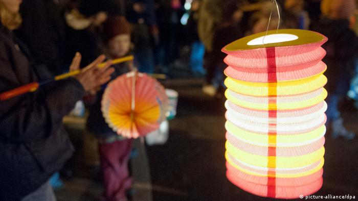 Children holding colourful lanterns on St Martins Day