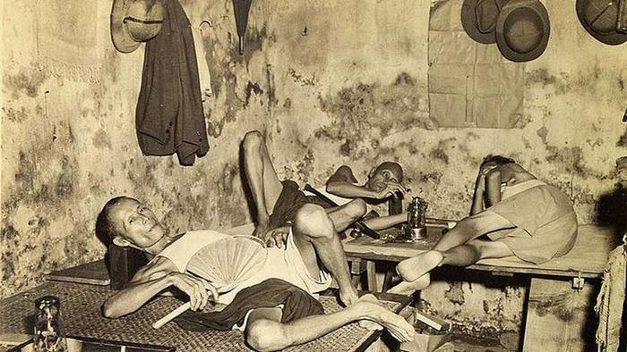 A little snooping in Chinatown will turn up the little opium dens stuck down an alley (not recommended without police escort). Actually, the smokers shown in this picture do it legally (Source: http://oldsite.library.upenn.edu/etext/sasia/calcutta1947/2.html) Author Claude Waddell, military photographer