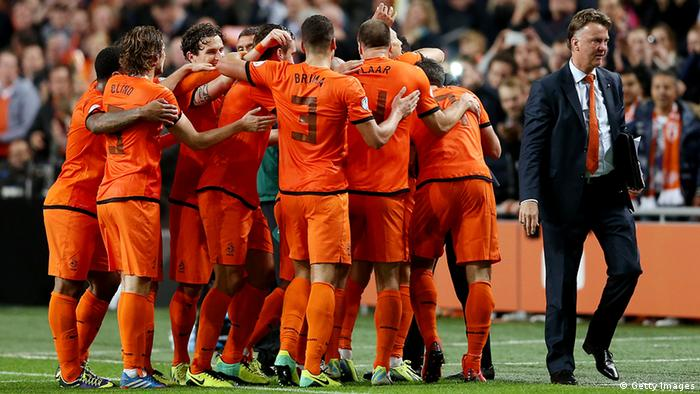 AMSTERDAM, NETHERLANDS - OCTOBER 11: Holland manager Louis van Gaal celebrates with his team during the FIFA 2014 World Cup Qualifing match between Holland and Hungary at Amsterdam Arena on October 11, 2013 in Amsterdam, Netherlands. (Photo by Scott Heavey/Getty Images)
