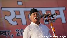 Mohan Bhagwat, chief of the Indian Rashtriya Swayamsevak Sangh (RSS) speaks during a party rally in Jammu on September 29, 2013. The Rashtriya Swayamsevak Sangh (RSS) is a right wing Hindu nationalist group volunteer organisation. AFP PHOTO/ STR (Photo credit should read STRDEL/AFP/Getty Images)